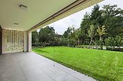 Architecture, new apartment, wide veranda with garden