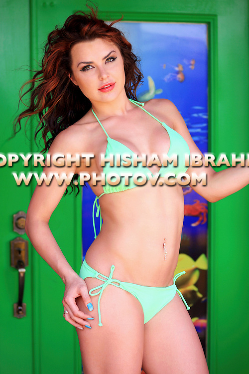 Sexy young Russian woman in green bikini, Freeport, Bahamas