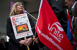 "© Licensed to London News Pictures. 04/04/2016. London, UK. A woman holds a banner reading ""Save Our Steel"" as workers from TATA Steel arrive at Congress House in London where they are due to hold a meeting, organised by the Trade Union Congress (TUC), to discuss the future of Port Talbot TATA steel works. Photo credit: Ben Cawthra/LNP"