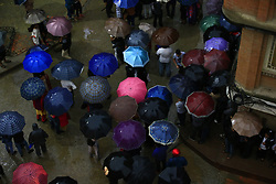 May 4, 2017 - Lalitpur, Nepal - People hold umbrellas to shelter from rainfall while observing the Rato Machindranath chariot festival in Lalitpur, Nepal on Thursday, May 04, 2017. (Credit Image: © Skanda Gautam via ZUMA Wire)