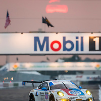 Sebring, FL - Mar 19, 2015:  The Wright Motorsports Porsche 911 GT America races through the turns at 12 Hours of Sebring at Sebring Raceway in Sebring, FL.