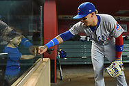 Aug 12, 2017; Phoenix, AZ, USA; Chicago Cubs infielder Javier Baez (9) fits bumps a young fan prior to the MLB game against the Arizona Diamondbacks at Chase Field. Mandatory Credit: Jennifer Stewart-USA TODAY Sports