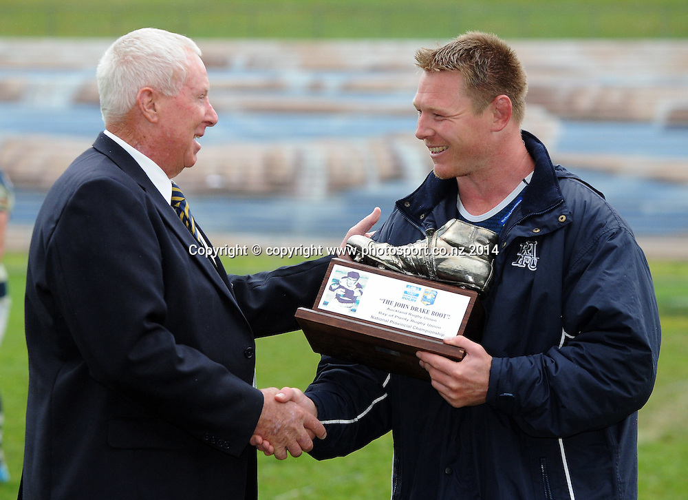 Auckland's Tom McCartney is presented with the John Drake Boot by Bay of Plenty rugby president John Dowling following the ITM Cup rugby match, Bay of Plenty vs Auckland, Rotorua International Stadium, Rotorua, September 13, 2014. Photo: Kerry Marshall / photosport.co.nz