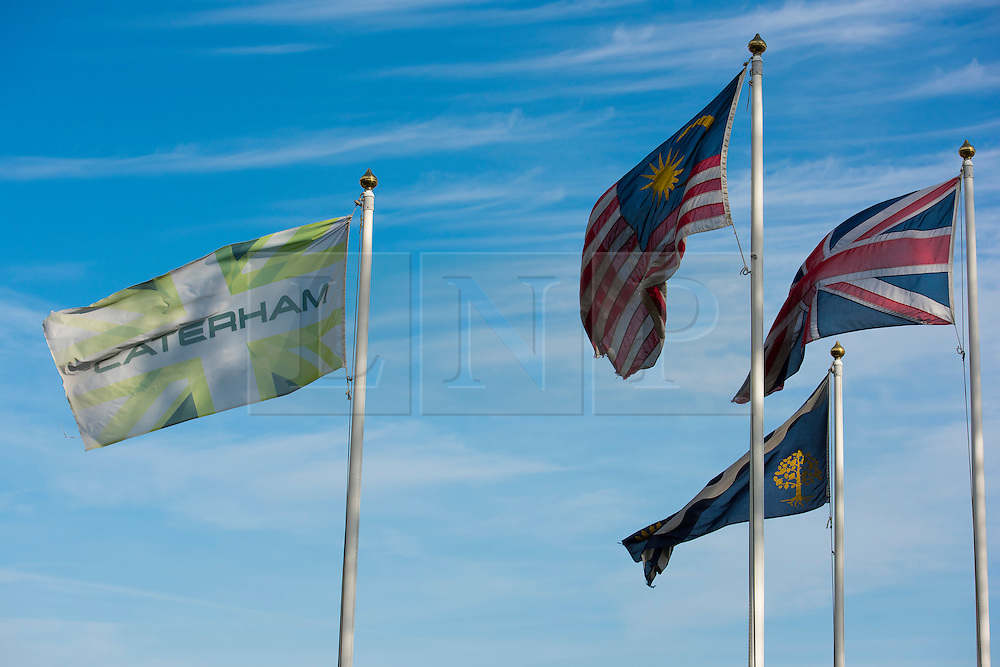 © Licensed to London News Pictures. 31/10/2014. Caterham F1 Leafield, Oxfordshire. Flags fly in the Autumn wind. Caterham F1 employees were called into work today but had to leave their cars outside on the road and pass through security to enter the F1 HQ at Leafield. The F1 team is now in Administration and will not be at the next two Grand Prix at Texas is the USA and Interlagos in Brazil. two F1 teams are now in administration caterham F1 and Marussia both based in Oxfordshire. Photo credit : MARK HEMSWORTH/LNP
