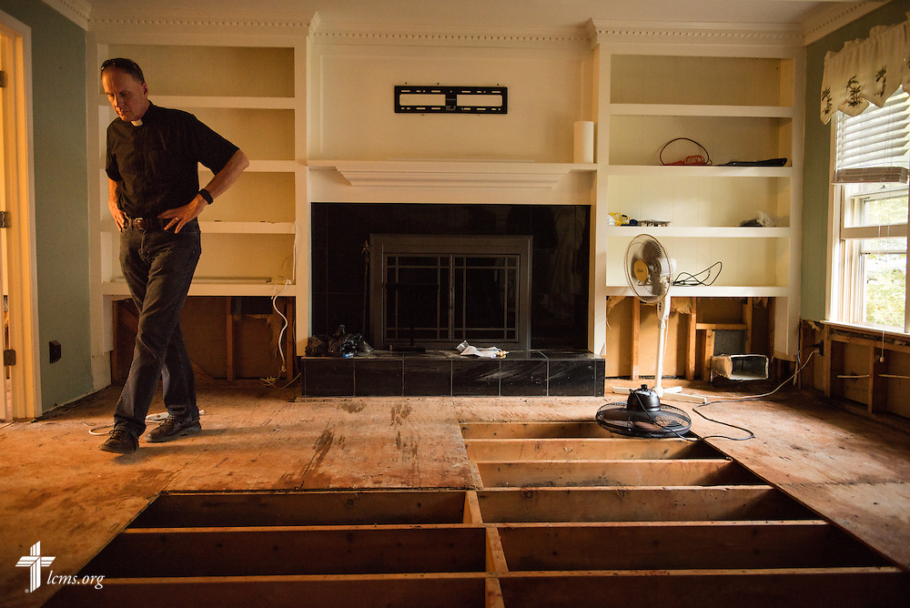 The Rev. Dr. John R. Denninger, LCMS Southeastern District president, surveys damage done to a home from a flood on Thursday, Oct. 8, 2015, in Irmo, S.C. LCMS Communications/Erik M. Lunsford