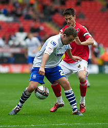 LONDON, ENGLAND - Saturday, October 8, 2011: Tranmere Rovers' Jose Baxter and Charlton Athletic's Johnnie Jackson during the Football League One match at The Valley. (Pic by Gareth Davies/Propaganda)