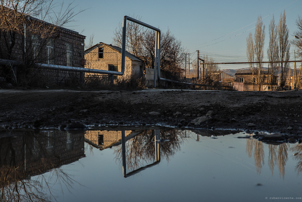Reflections of gas pipes on a pond. Gyumri, Armenia