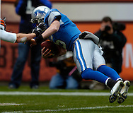 MORNING JOURNAL/DAVID RICHARD.Detroit quarterback Jeff Garcia dives into the end zone for a touchdown yesterday in the second quarter..
