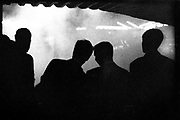 Silhouttes of office blokes on the pull at the Hippodrome nightclub Leicester Square London 1992.