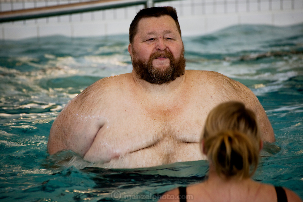 Rick Bumgardener takes a water exercise class after a gym workout at the Mercy Health and Fitness Center near his home in Halls Tennessee.  (From the book What I Eat: Around the World in 80 Diets.) The caloric value of his day's worth of food in the month of February was 1,600 kcals. He is 54; 5 feet nine inches tall,  and 468 pounds.  Rick's new lifestyle rules out one of his favorite restaurant dinners with his wife, Connie, and son, Greg: three extra-large pizzas, crazy bread, and no vegetables. There would be leftovers, but not for long, Rick says, as he would eat all of them.  MODEL RELEASED.