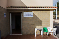 CALTANISSETTA, ITALY - 28 NOVEMBER 2014: Entrance to the Territorial Commission for Refugee Status, where asylum seekers' cases are examined, at the Pian del Lago CARA (Accommodation Centre for Asylum Seekers) in Caltanissetta, Italy, on November 28th 2014. To this date, the Pian de Lago CARA hosts 491 asylum seekers, while 40 illegal immigrants are held in the CIE (Center for Identification and Deportation), before being deported.