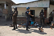 A French peacekeeper leads an arrest operation in the Cité-de-Dieu neighbourhood of Port-au-Prince, one of many arrest operations condemned by local and international human rights organizations. Concordia Media Gallery, Montreal, 2010.