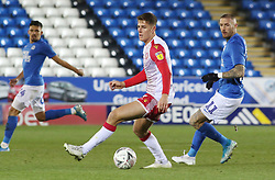 Charlie Carter of Stevenage in action with Marcus Maddison of Peterborough United - Mandatory by-line: Joe Dent/JMP - 19/11/2019 - FOOTBALL - Weston Homes Stadium - Peterborough, England - Peterborough United v Stevenage - Emirates FA Cup first round replay