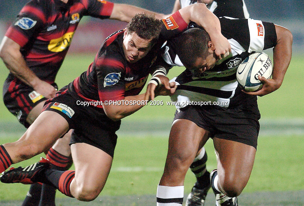 Hawkes Bay's Peniasi Tokakece is tackled by Canterbury's Tim Bateman during the Air New Zealand Cup week 1 rugby match between Hawke's Bay and Canterbury at Mclean Park, Napier on Friday 28 July 2006. Photo: John Cowpland/PHOTOSPORT<br /> <br /> <br /> <br /> <br /> <br /> 280706