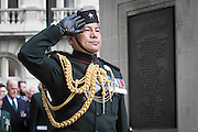 Photographer: Rick Findler<br /> <br /> 30.04.15 The Brigade of Gurkhas today celebrated their service in every major conflict in which Britain has been involved in for the last 200 years. To celebrate this heritage the Brigade of Gurkhas marched from Wellington Barracks down the Mall to the Gurkha Statue in Whitehall and held a memorial service for the rich Gurkha history. <br /> Pictured: A highly decorated Gurkha salutes in front of a newly refurbished plate on the Gurkha Statue.