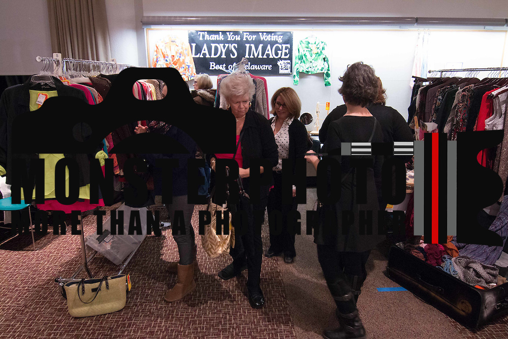 Shoppers browse though racks of fashions at the Lady's Image booth during the 3rd Annual Guilty Girls Warehouse Sale Friday, Feb. 06, 2015 at University of Delaware's Arsht Hall in Wilmington, DE.
