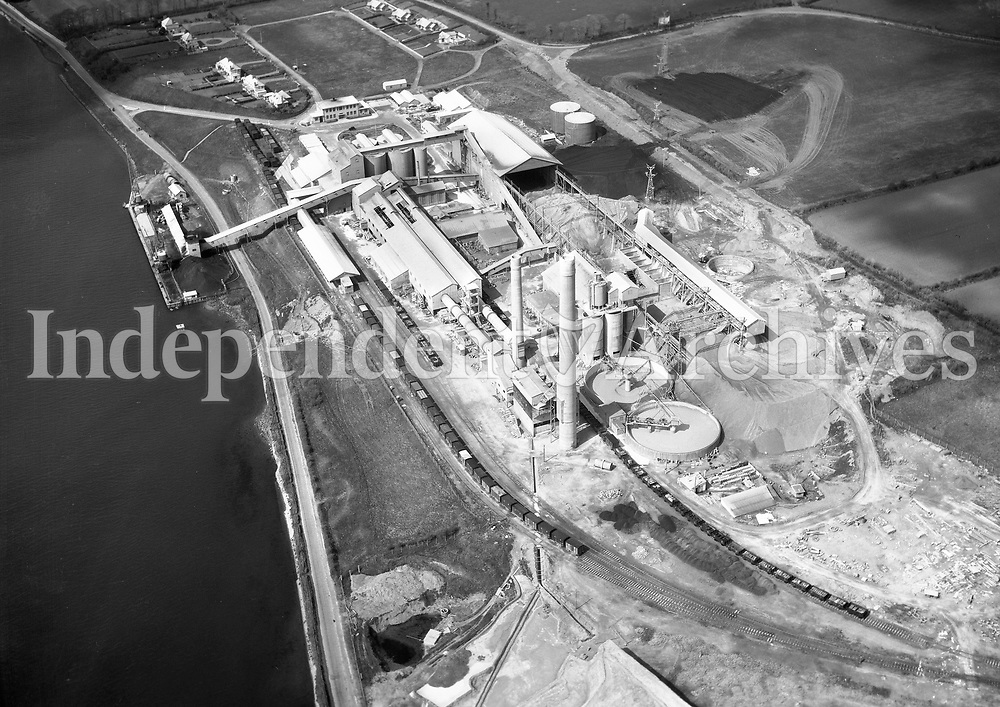 A107 Cement Ltd, Drogheda.    (Part of the Independent Newspapers Ireland/NLI collection.)<br /> <br /> <br /> These aerial views of Ireland from the Morgan Collection were taken during the mid-1950's, comprising medium and low altitude black-and-white birds-eye views of places and events, many of which were commissioned by clients. From 1951 to 1958 a different aerial picture was published each Friday in the Irish Independent in a series called, 'Views from the Air'.<br /> The photographer was Alexander 'Monkey' Campbell Morgan (1919-1958). Born in London and part of the Royal Artillery Air Corps, on leaving the army he started Aerophotos in Ireland. He was killed when, on business, his plane crashed flying from Shannon.