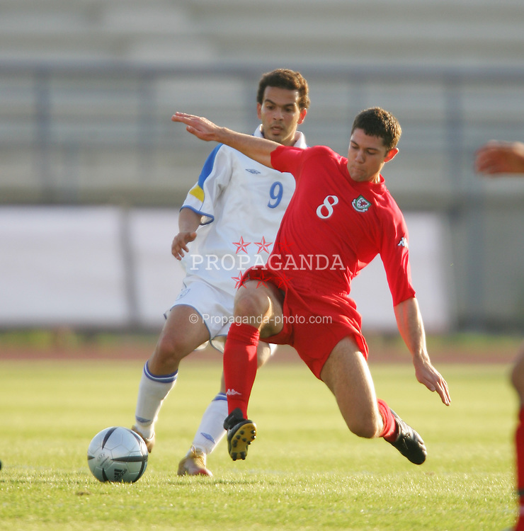 PAPHOS, CYPRUS - TUESDAY, NOVEMBER 15th, 2005: Wales' Anthony Pulis and Cyprus' Michaels Pavlou during the Under-21 International Friendly match at the Paphiako Stadium. (Pic by David Rawcliffe/Propaganda)