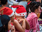 17 SEPTEMBER 2015 - BANGKOK, THAILAND:  A participant in the Santa pageant rests between around at the World Santa Claus Congress. Twenty-six Santa Clauses from around the world are in Bangkok for the first World Santa Claus Congress. The World Santa Claus Congress has been an annual event in Denmark since 1957. This year's event, hosted by Snow Town, a theme park with a winter and snow theme, hosted the event. There were Santas from Japan, Hong Kong, the US, Canada, Germany, France and Denmark. They presented gifts to Thai children and judged a Santa pageant. Thailand, a Buddhist country, does not celebrate the religious aspects of Christmas, but Thais do celebrate the commercial aspects of the holiday.   PHOTO BY JACK KURTZ