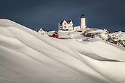 This scene really sums up the amount of snow we've had this year on the coast of Maine. Nubble Lighthouse on Cape Neddick really defines Maine in many people's minds.