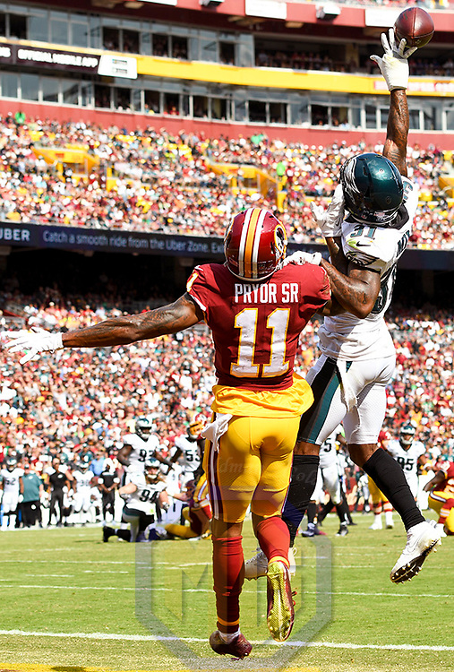 LANDOVER, MD - SEPTEMBER 10: Philadelphia Eagles cornerback Jalen Mills (31) deflects a third quarter pass intended for Washington Redskins wide receiver Terrelle Pryor (11) in the end zone on September 10, 2017, at FedExField in Landover, MD.  The Philadelphia Eagles defeated the Washington Redskins, 30-17.  (Photo by Mark Goldman/Icon Sportswire)