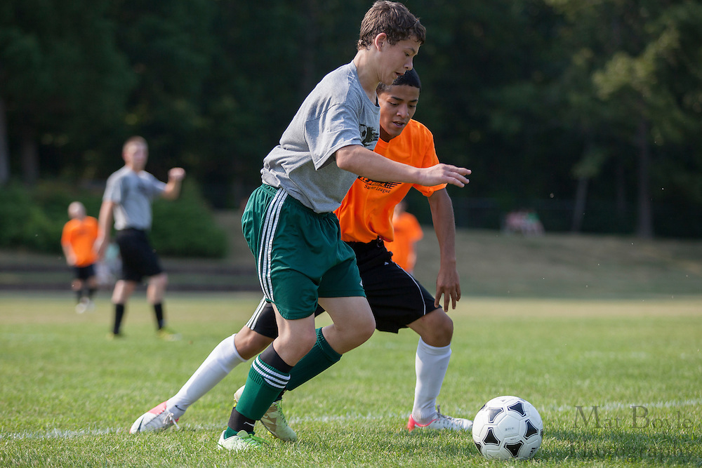 Pitman High School Soccer vs Audubon High School in a summer league match at Alcyon Park in Pitman, NJ on June 28, 2012. (photo / Mat Boyle)