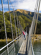 Suspension Bridge crossing the Mararoa River; Scene from Mavora Lakes Park, near Mossburn, Southland, New Zealand.