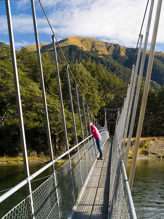 Suspension Bridge crossing the Mararoa River; Scene from Mavora Lakes Park, near Mossburn, Southland, New Zealand.