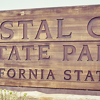 Crystal Cove State Park sign panorama photo in Laguna Beach California. Crystal Cove State Park is a popular attraction in Orange County with beaches, walking trails and tide pools along the Pacific Ocean.