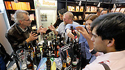 "Frankfurt Book Fair 2014, biggest of its kind in the World. Beer tasting at Oktober Verlag to honor the introduction of Jürgen Roth's (l.) new book ""Die Poesie des Biers 2""."