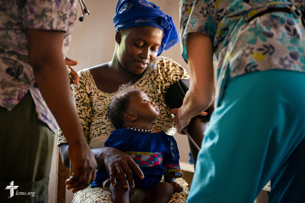 A mother and her child are seen on the second day of the LCMS Mercy Medical Team on Tuesday, May 8, 2018, in the Yardu village outside Koidu, Sierra Leone, West Africa. LCMS Communications/Erik M. Lunsford