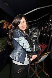 ESTELLA THOMAS and her dog Coco at the launch of George's Dinner for Dogs menu in aid of The Dog's Trust held at George, 87-88 Mount Street, London on 19th March 2013.