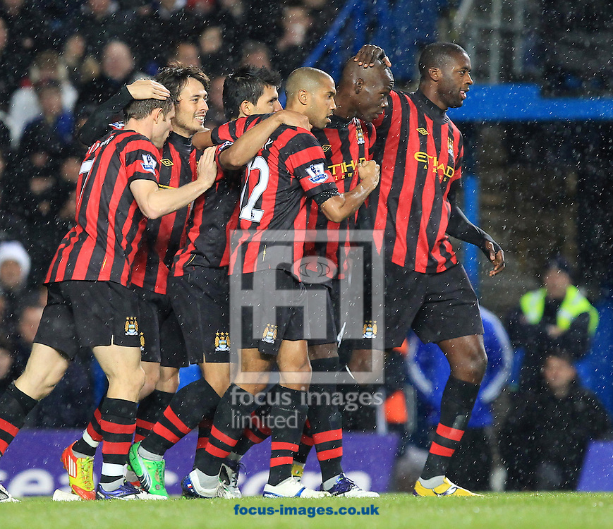 Picture by John Rainford/Focus Images Ltd. 07506 538356.12/12/11.Mario Balotelli of Manchester City celebrates with team-mates after scoring against Chelsea in the Barclays Premier League match at Stamford Bridge stadium, London.