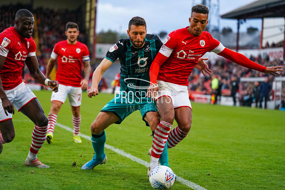 Swansea City forward Borja Gonzalez (9) and Barnsley forward Jacob Brown (7) in action during the EFL Sky Bet Championship match between Barnsley and Swansea City at Oakwell, Barnsley, England on 19 October 2019.