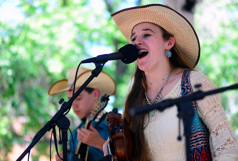 apl071617a/ASECTION/pierre-louis/JOURNAL 071517<br /> 16 year-old Leah Sawyer,,of Weatherford, , Texas, belts out a song while performing with her 14 year-old brother David Sawyer,, at the Western Music Youth Day held at at the Old Town Gazebo .Photographed on Sunday July  16,  2017. .Adolphe Pierre-Louis/JOURNAL