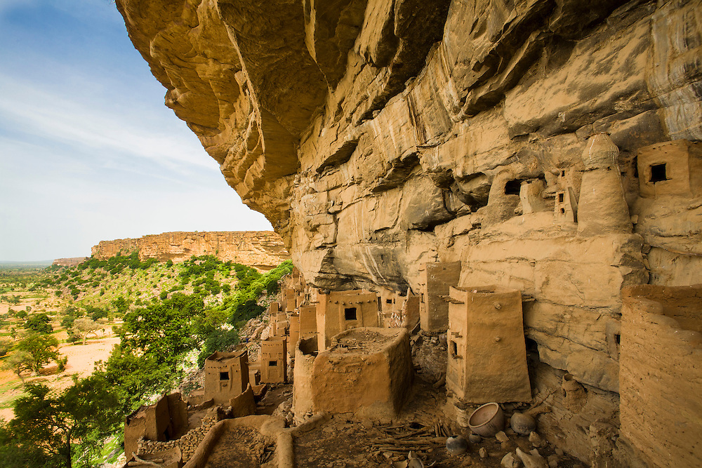 The well-preserved Tellem dwellings in Teli makes it one of the most picturesque villages in the Dogon Country. As in many other villages, the Dogon formerly lived sheltered in the cliffs as they feared predators and human agressors. Only some 60 ago, Teli villagers started to settle in the present village below the cliff. The Dogon Country is the most visited part of Mali with tourists visiting its tipical  villages that can be located on the cliff, on the sandy plain or in the rocky plateau