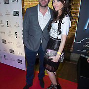 NLD/Amsterdam/20140124 - inloop E-entertainment Red Carpet party, Dean Saunders en partner Jamie Faber