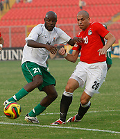 Photo: Steve Bond/Richard Lane Photography.<br />Egypt v Zambia. Africa Cup of Nations. 30/01/2008. James Chamanga (L) and Wael Gomaa (R) tussle for the ball
