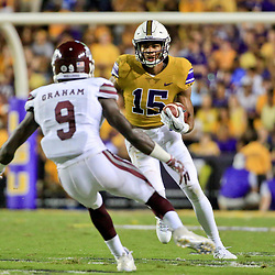 Sep 17, 2016; Baton Rouge, LA, USA; LSU Tigers wide receiver Malachi Dupre (15) is pursued by Mississippi State Bulldogs defensive back Jamoral Graham (9) during the second quarter of a game at Tiger Stadium. Mandatory Credit: Derick E. Hingle-USA TODAY Sports