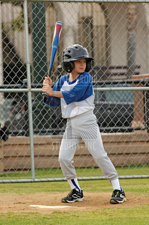 A young boy up to bat in the little leagues