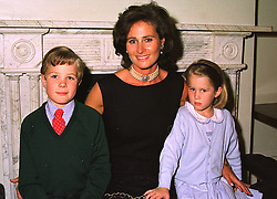 The COUNTESS OF CALEDON with her children, the HON.LEONORA ALEXANDER and VISCOUNT ALEXANDER at a dinner in London on 6th July 1998.MIX 3