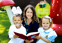 No Fee for Repro: 26/07/2012.'Alice' Kayla Cooke aged 5 from Drumcondra, Dublin and 'Rabbit' Brandon Best-Blake aged 5 from Clondalkin, pictured with Ireland's new children's laureate Niamh Sharkey who pledged her support for the Eason 'Get Into Reading' campaign which aims to highlight the importance of reading, especially with young children. Eason commissioned research into the nation's reading habits which revealed almost one in five (18%) Irish parents never read to their children. Eason is asking the Irish public to pledge their support at Easons.com/getintoreading. Pic Andres Poveda CPR.