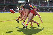 Brandon Jack of the Swans and Nick Haynes of the Giants get tangled during the 2013 AFL Round 16 match between the Sydney Swans and the GWS Giants at the SCG, Sydney on July 14, 2013. (Photo: Craig Golding/AFL Media)