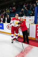KAMLOOPS, CANADA - NOVEMBER 5: Shen, Pavel #16 of Team Russia accepts player of the game award after the loss to Team WHL on November 5, 2018 at Sandman Centre in Kamloops, British Columbia, Canada.  (Photo by Marissa Baecker/Shoot the Breeze)