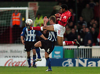 Fotball<br /> England 2004<br /> 13.11.2004<br /> Foto: SBI/Digitalsport<br /> NORWAY ONLY<br /> <br /> Swindon Town v Sheffield Wednesday<br /> FA Cup<br /> <br /> Swindon's Jerel Ifil wins the ball.