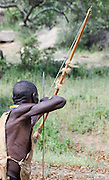 Africa, Tanzania, Lake Eyasi, Hadza tribe. A small tribe of hunter gatherers AKA Hadzabe Tribe. Man hunts with bow and arrow