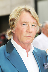 © Licensed to London News Pictures. 01/07/2013. London, UK. Rick Parfitt at the Bula Quo UK film premiere, Odeon West End cinema Leicester Square, London. Photo credit: Richard Goldschmidt/LNP
