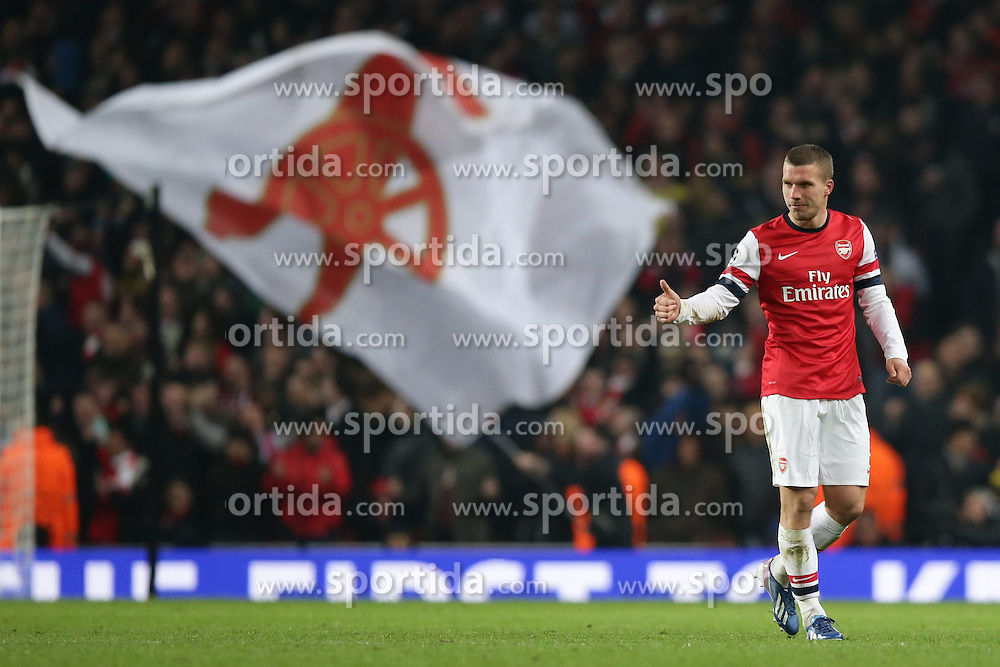 19.02.2013, Emirates Stadion, London, ENG, UEFA Champions League, FC Arsenal vs FC Bayern Muenchen, Achtelfinale Hinspiel, im Bild, Lukas PODOLSKI (FC Arsenal London - 9) jubelt mit Daumen hoch- im hintergrund die Arsenal Fahne der Gooners // during the UEFA Champions League last sixteen first leg match between Arsenal FC and FC Bayern Munich at the Emirates Stadium, London, Great Britain on 2013/02/19. EXPA Pictures © 2013, PhotoCredit: EXPA/ Eibner/ Gerry Schmit..***** ATTENTION - OUT OF GER *****