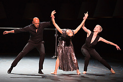 "© Licensed to London News Pictures. 14/04/2015 London, England. L-R: Gaetan Morlotti, Diana Vishneva and Bernice Coppieters. Diana Vishneva, star of the Mariinsky Ballet and the American Ballet Theatre, performs the piece ""Switch"" at a photocall for the UK premiere of Diana Vishneva: On the Edge at the London Coliseum. The show runs from for three performances on 14, 16 and 18 April 2015. Dancers: Diana Vishneva, Bernice Coppieters and Gaetan Morlotti. Choreography by Jean-Christophe Maillot. Diana Vishneva's costume was created by Karl Lagerfeld. Photo credit: Bettina Strenske/LNP"