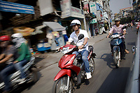 Tran Van Giap rides his motor bike in the traffic of Ho Chi Minh City.